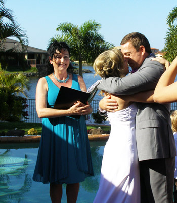 Atanas and Chantel kiss to seal their marriage at Monterey Keys on the Gold coast with Marilyn Verschuure as Wedding Celebrant