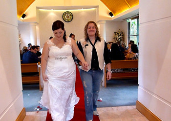 Donna & Bridget walk down the aisle ot the chapel together in the at the Crowne Plaza Surfer's Paradise on the Central Gold Coast.