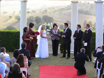 Kirsty & Vladimir exchange roses at their wedding with Marilyn Verschuure Marry Me Marilyn at the Glengariff Historic Estate and Winery in the Dayboro Valley north of Brisbane