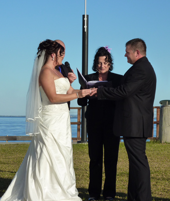 Leisha and Jeff Exchange Rings at Woody Point on the Redcliffe Peninsularwith Marilyn Verschuure from Marry Me Marilyn