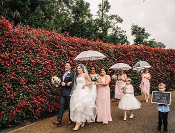 Marry Me Marilyn_Samantha_Michael_Wedding Tamborine Gardens Outside Chapel with Umbrellas
