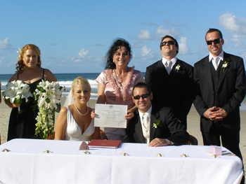 Prenetation of Marriage Cerrtificate to Anglea and David at their Marriage on Palm Beach on the Gold Coast